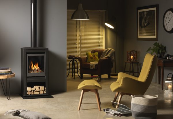 Valor Inspire Large Stove lifestyle right angle with logs